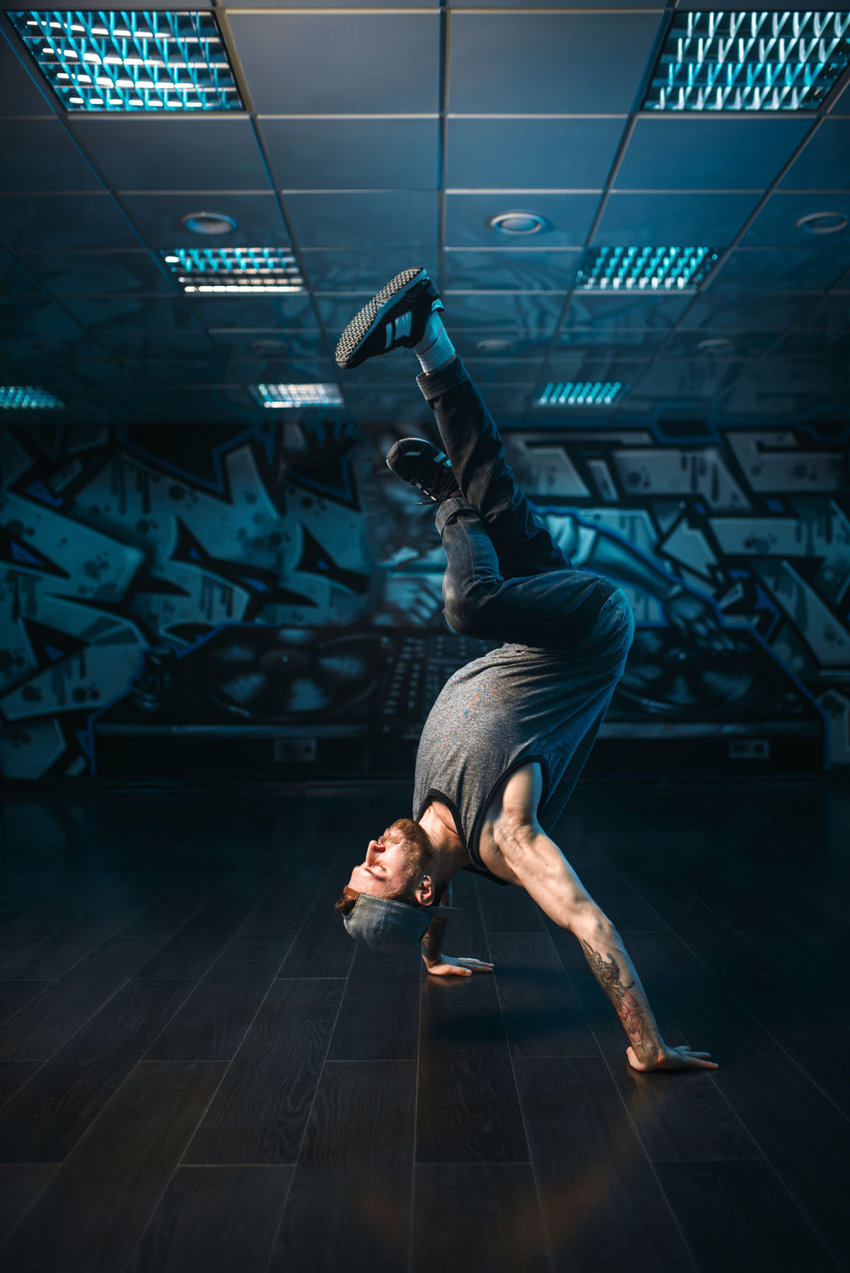 Hip hop motions, male performer in dance studio. Modern urban dancing style